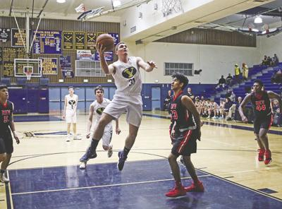 Yucaipa High School's boys basketball team home opener spoiled by Redlands East Valley
