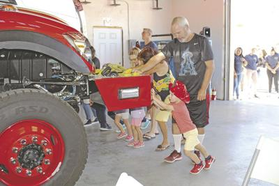 Yucaipa community helps 'push in' new Yucaipa fire engine
