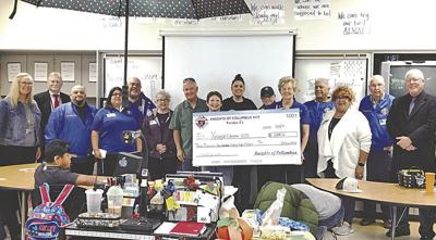 Knights of Columbus donate $3,188 to a local school