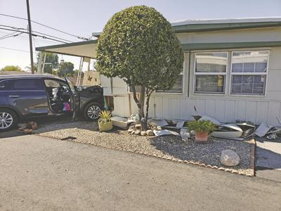 Vehicle crashes into mobilehome