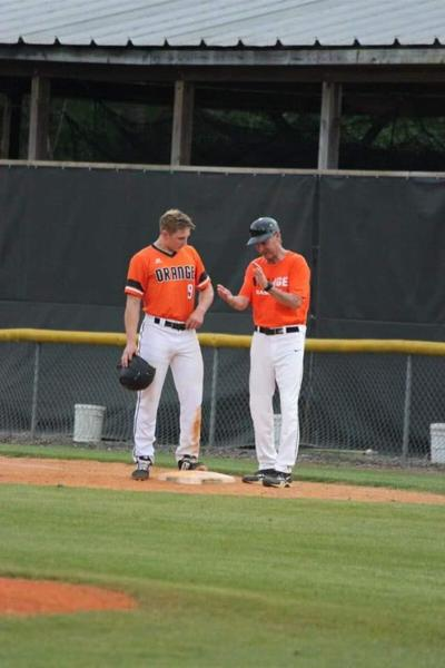 Orange right fielder Colin Guentensberger with head coach Jason Knapp during a victory over Chapel Hill on April 25