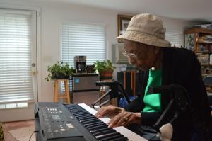 """<p>Odell Ross, 102, plays her favorite hymn on the keyboard, """"What a Fellowship."""" Ross is a native of Hurdle Mills.</p>"""