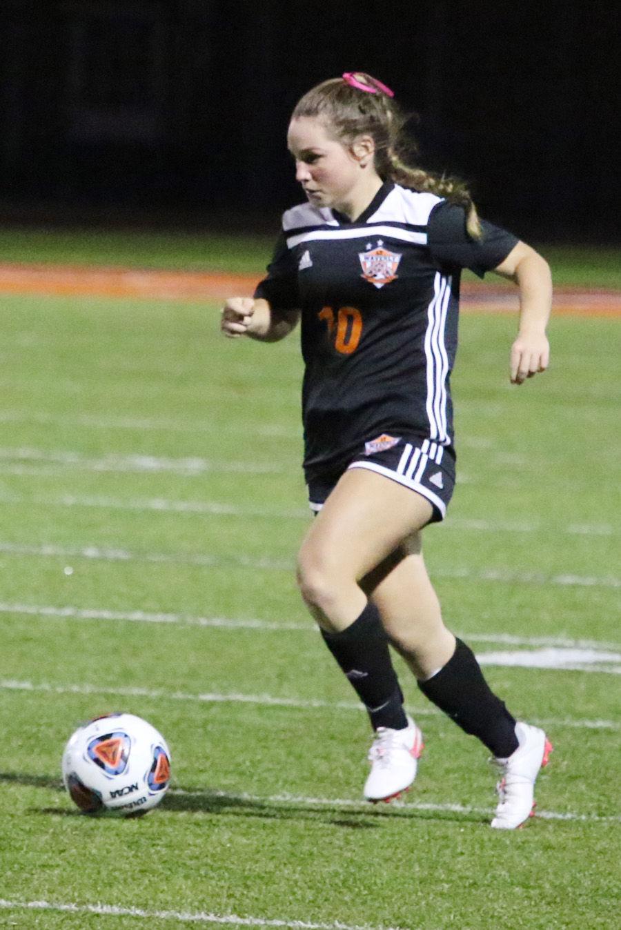 Amelia Willis push ball up field