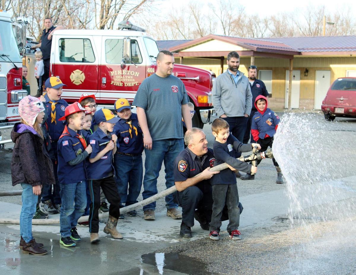 Cub Scouts-PFD fire hose