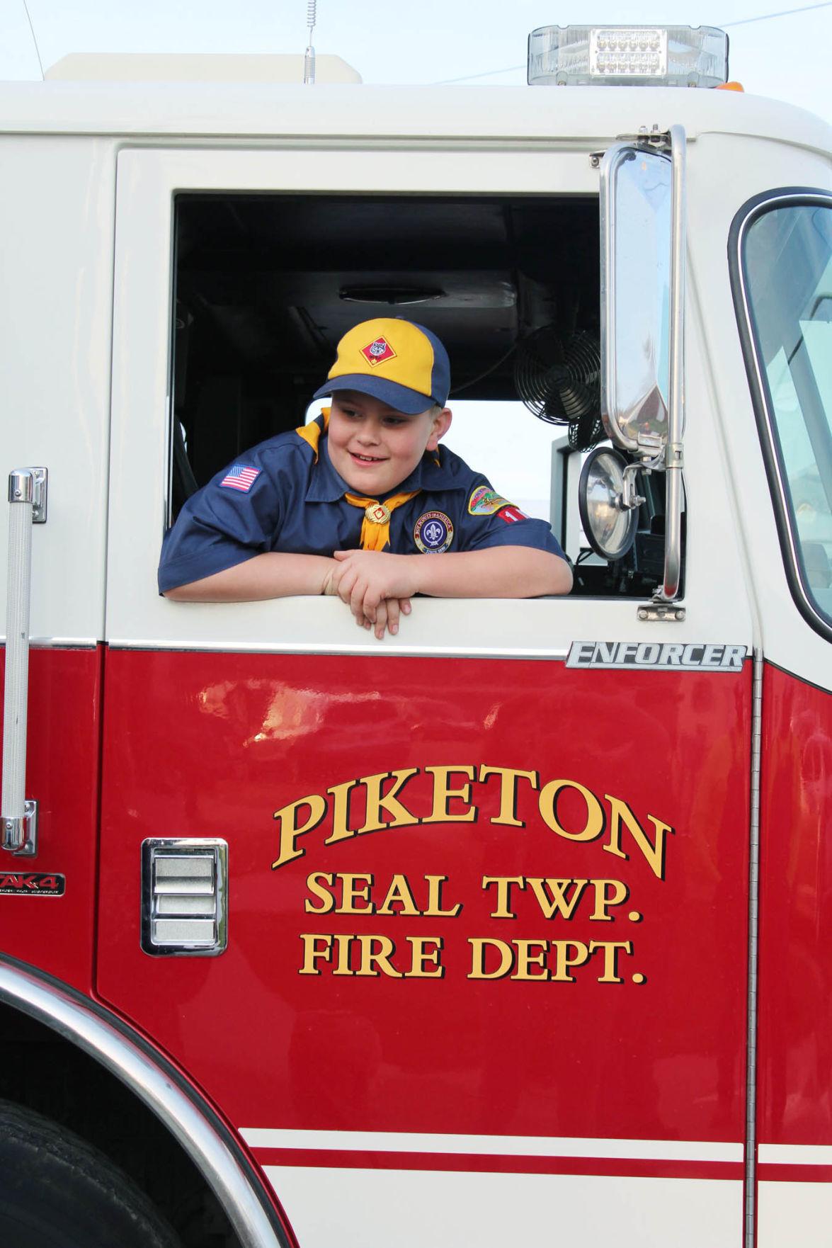 Cub Scouts-PFD boy in truck look out window