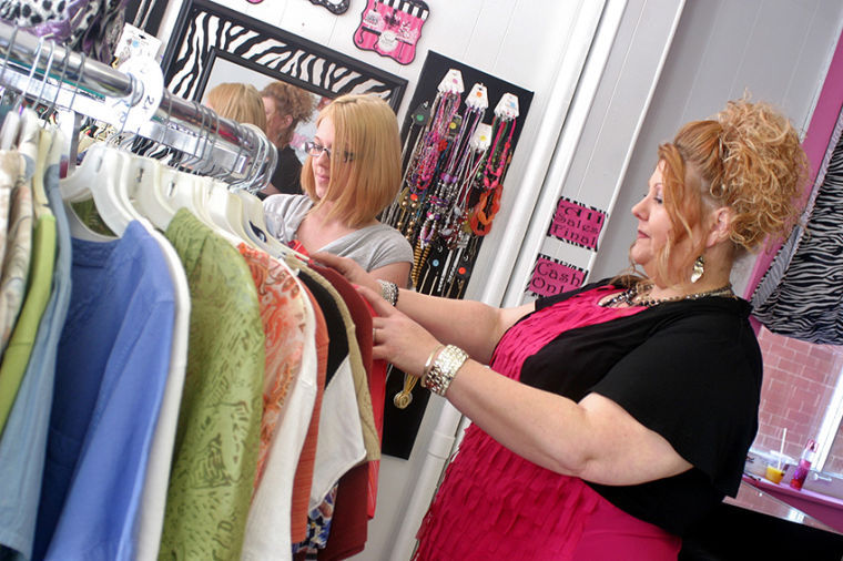 5e4623b571 Myra Jackson, of Waverly, and her sister Sarah Simmons arrange women's  blouses on a rack inside their newly-opened clothing store, The Sassy  Zebra, ...