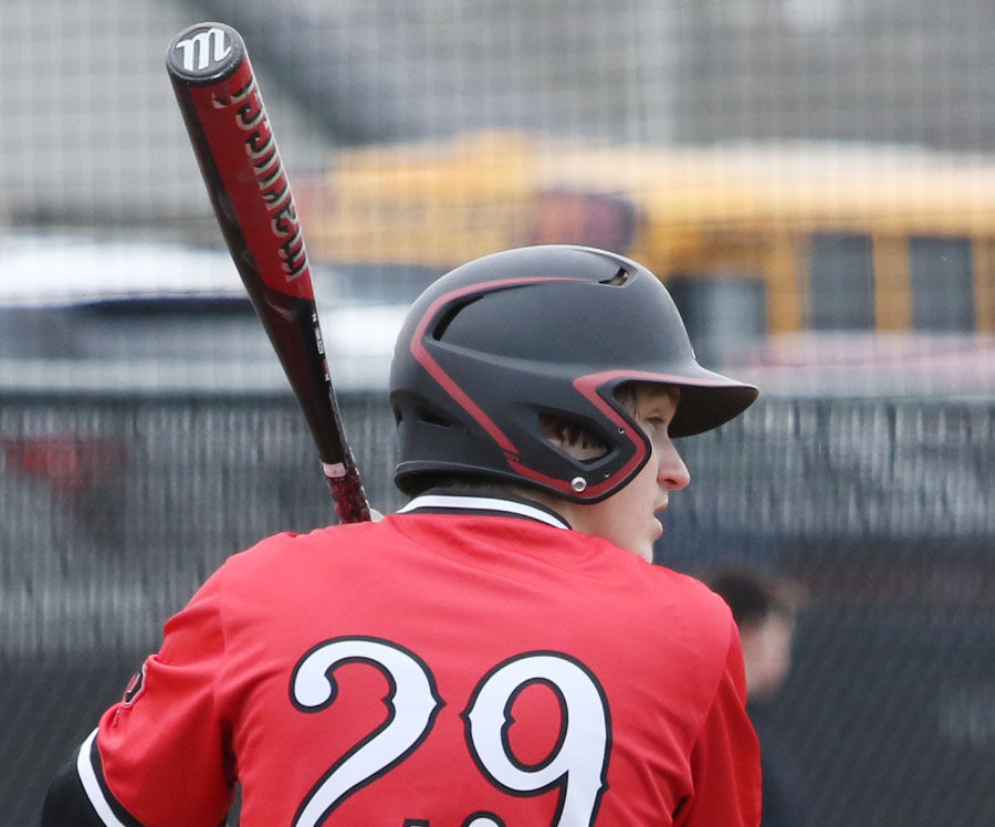 Streaks open with DH behind new backstop, Page B1