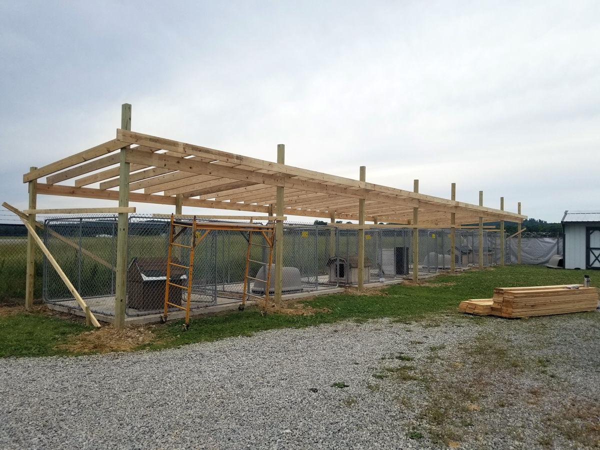 Outdoor kennel roofing project underway at Pike dog pound
