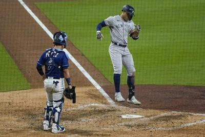 Stanton, Yankees power way to win against Rays in opener