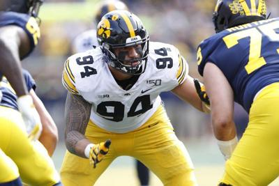 Bills sign top draft pick DE A.J. Epenesa, two others