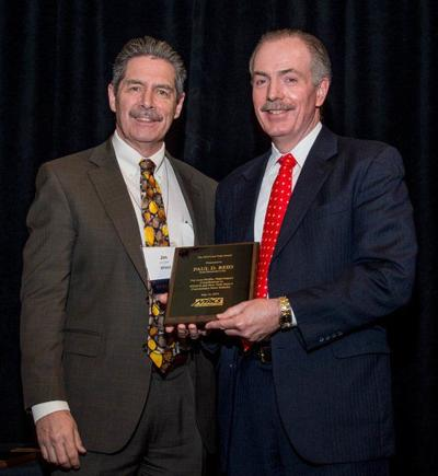 Paul Reid honored with Carl Tripi Award