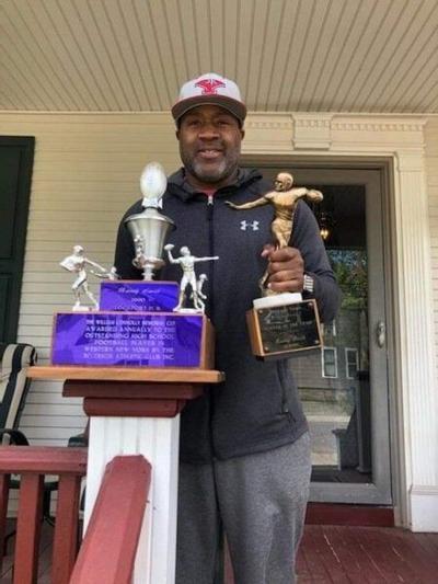 Former Lockport, YSU football star Randy Smith donates trophies