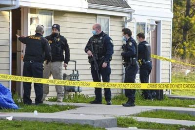 Police say shooting, stabbing being probed as double homicide