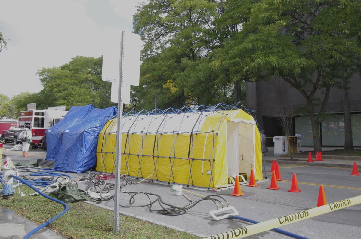 Hazardous Building Material : Material in envelope at seneca office building determined