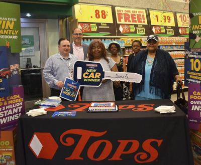 Falls woman wins car in Tops Monopoly game