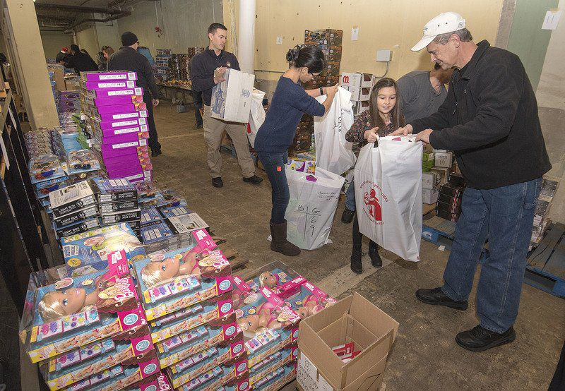 5a73e50cb4 ... help loading toys from Captain Tom Jelen as volunteers form an assembly  line to pack toys for local needy children