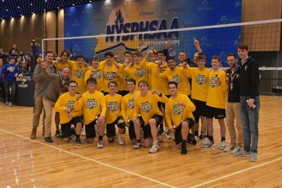 Boys volleyball wins first team state title in GI history