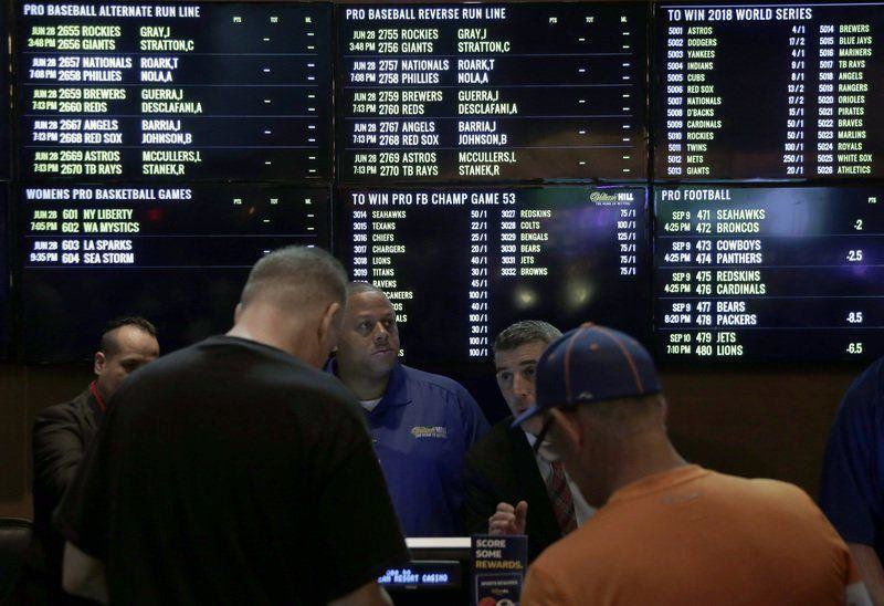 Fantasy sports businesses move to put odds in their favor