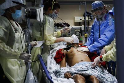 Virus Outbreak Half Million Dead Photo Gallery