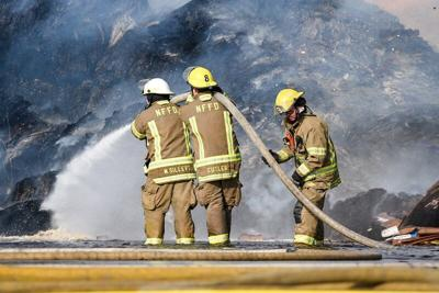 Greenpac fire contained as crews work to extinguish blaze