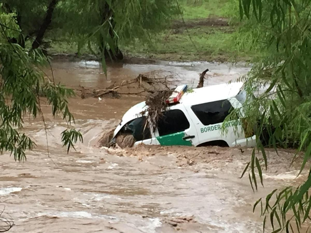 Law enforcement vehicles get stuck, soaked by floodwaters