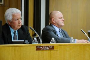 Interim city attorney defends his position