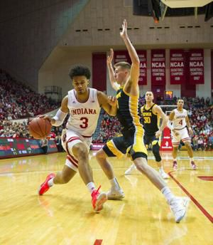 Indiana uses 3-point flurry to beat No. 21 Iowa, end skid