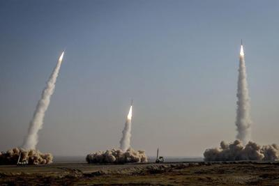 Iran's Revolutionary Guard Corps launches missiles during a military drill in an unknown location in central Iran on Jan. 15, 2021.