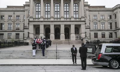 """Members of Georgia's Black Caucus follow an honor guard carrying the casket of Rep. John Lewis from the Capitol on July 30, 2020 in Atlanta, Georgia. On the sixth day of the """"Celebration of Life"""" for Rep. John Lewis, after traveling via motorcade from the Georgia state Capitol where he was lying in state overnight, his funeral is to be held at Ebeneezer Baptist Church in Atlanta, with burial to follow."""
