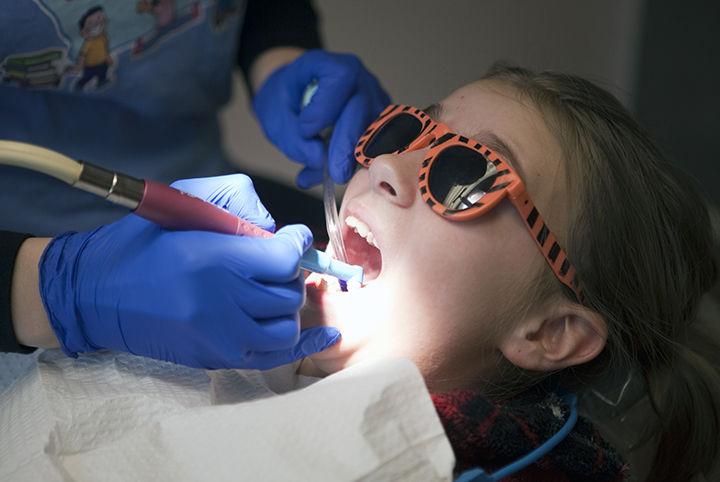 Dentists give care to local students