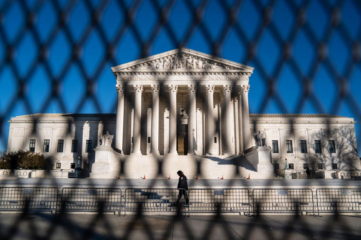 Heightened security measures are in place around the Supreme Court, days after a violent mob of President Donald Trump's supporters swarmed the U.S. Capitol, disrupting Congress' vote to certify the 2020 election results, on Saturday, Jan. 9, 2021, in Washington, D.C..