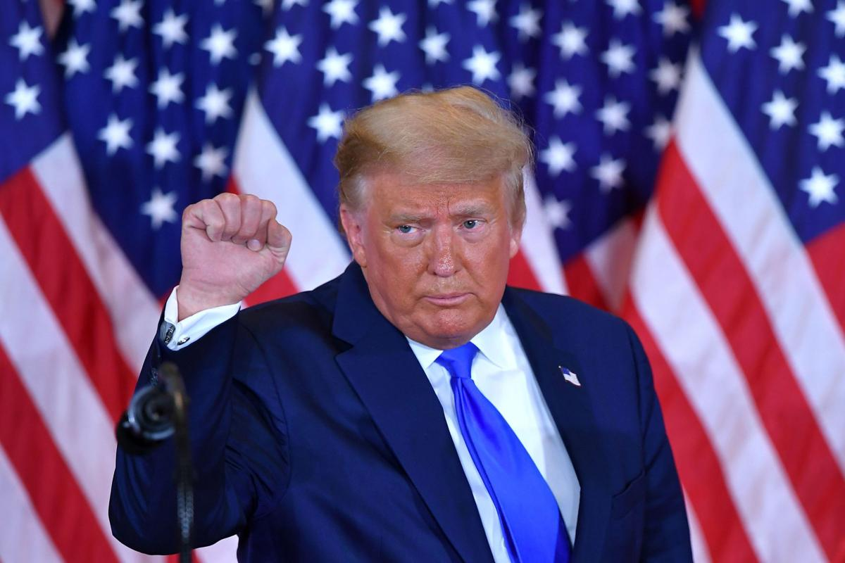 President Donald Trump pumps his fist after speaking during election night in the East Room of the White House in Washington, D.C., early on November 4, 2020.