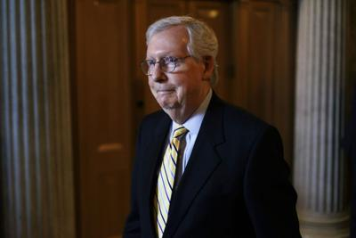 Mitch McConnell, R- Ky., walks in a hallway after a vote at the Senate chamber at the U.S. Capitol June 22, 2021, in Washington, D.C..