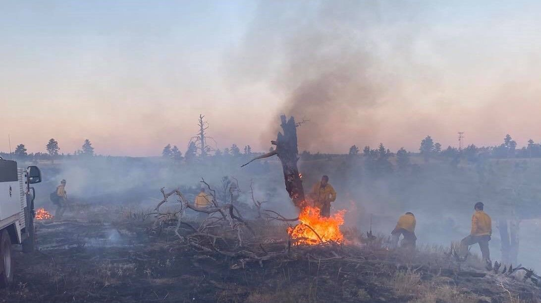 Crews tamp down fires