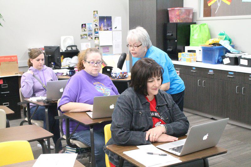 NPS teachers receive laptops in one-to-one initiative