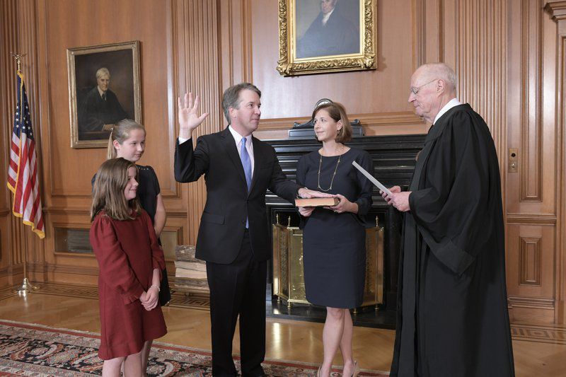 Debated Supreme Court candidate sworn in after narrowest Senate vote in over a century