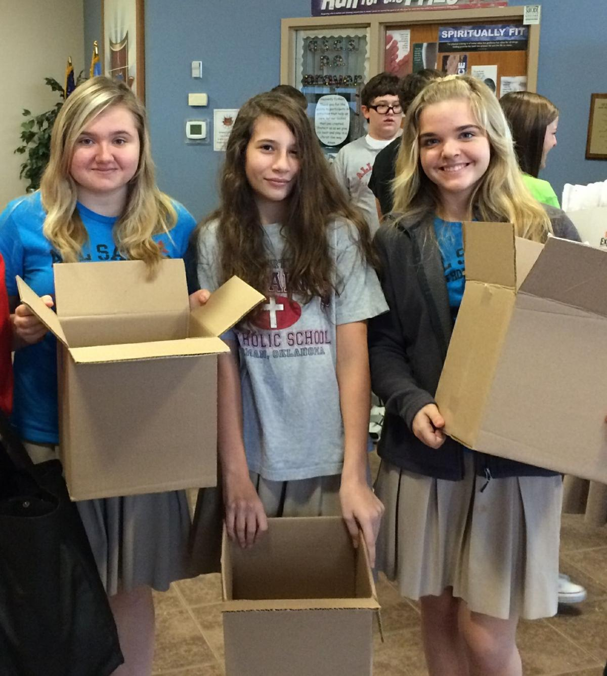 Students package gifts for children of incarcerated parents