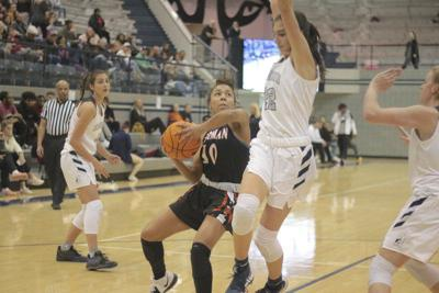 High school basketball: Late free throws save Norman High in win over Edmond North