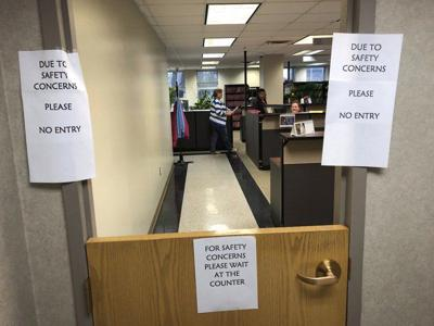 County courthouse suspends jury term;access to building restricted