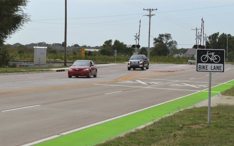 City contractors close to finishing first stretch of green bike lanes in Norman