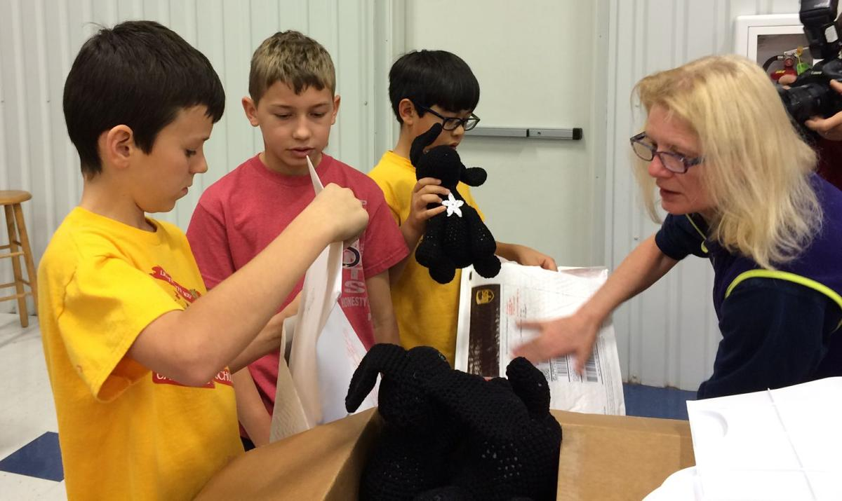 All Saints students prepare gifts