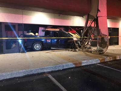 Truck crashes into building