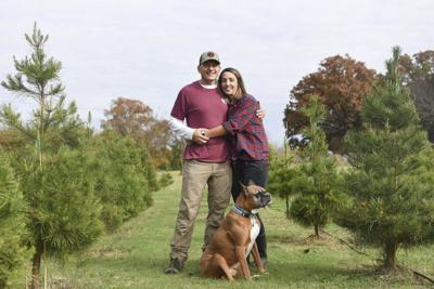 Coupleencouraging pet adoption through event