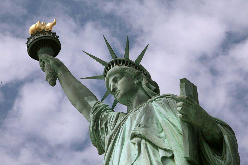 Biographer: Statue poem embraces migrants
