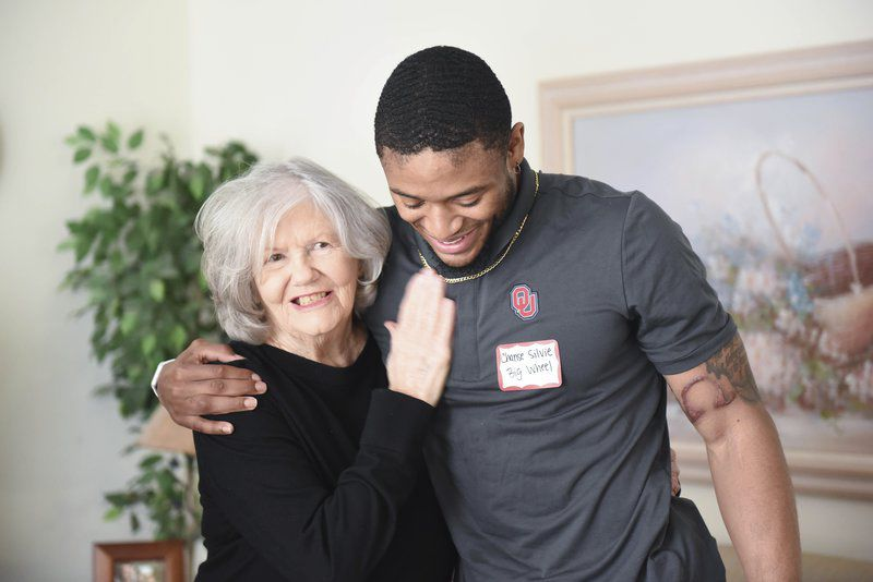 OU football player surprises Meals on Wheels client