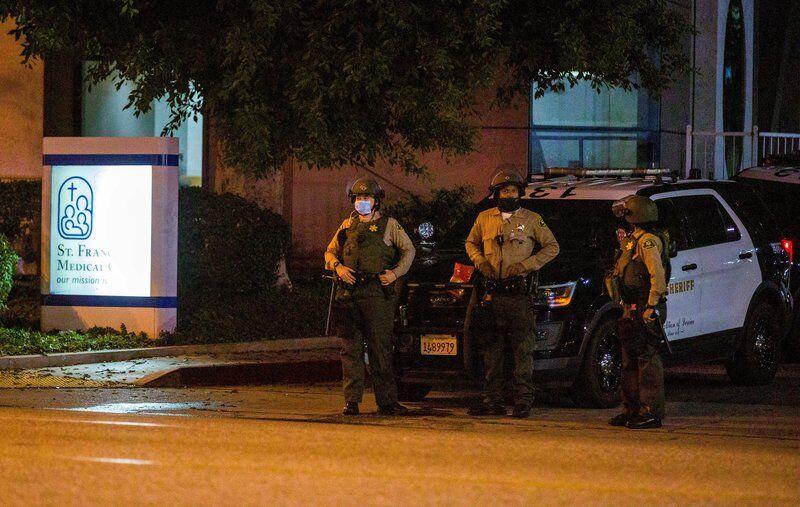Gunman sought after California deputies shot in patrol car