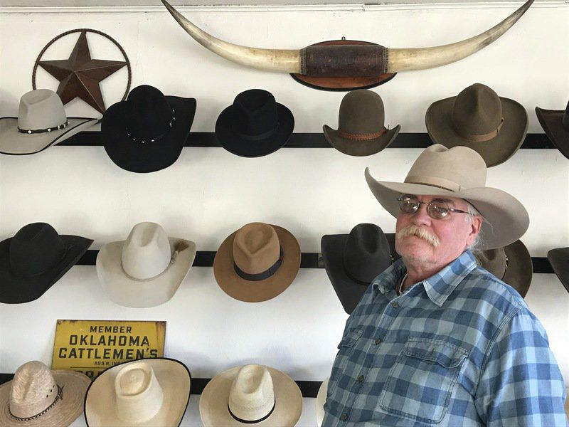 Hat shop owner making handmade creations  405fcd1c1f0