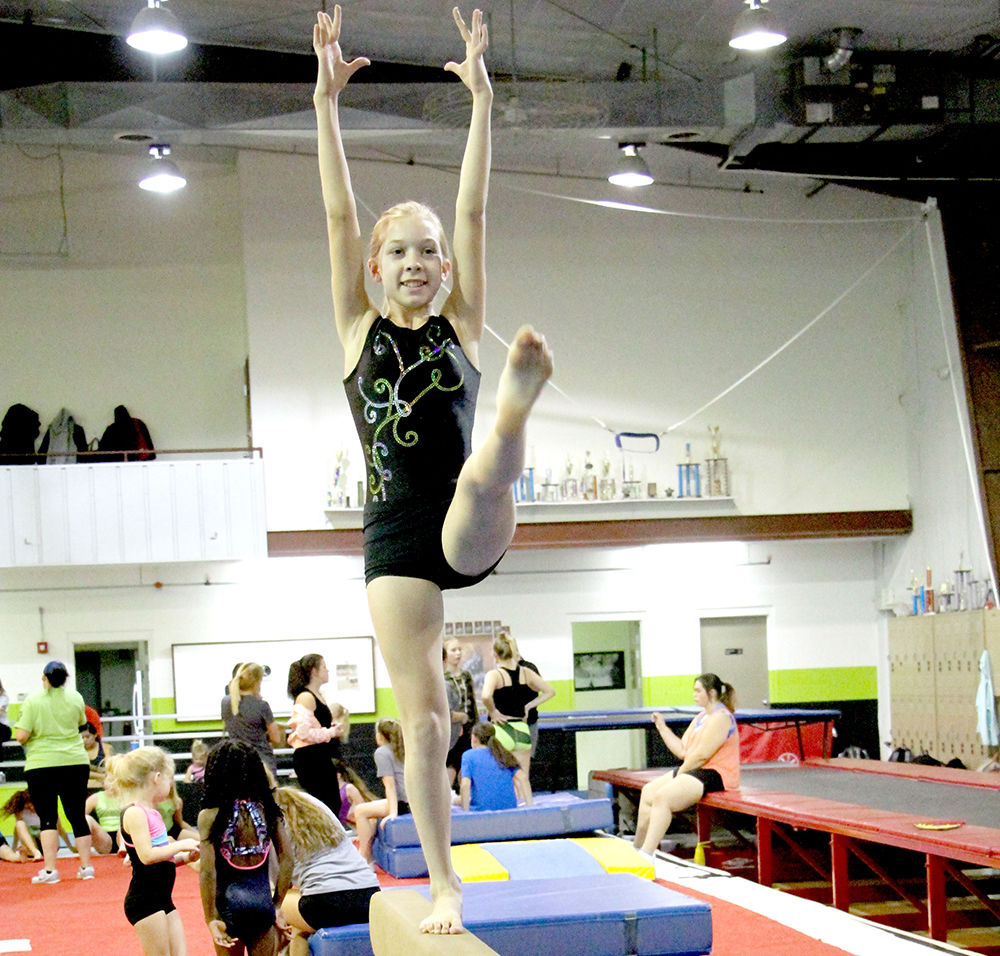 Raising the bar: Junior gymnasts work together to prepare for state ...