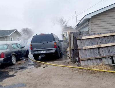 Firefighters extinguish SUV fire
