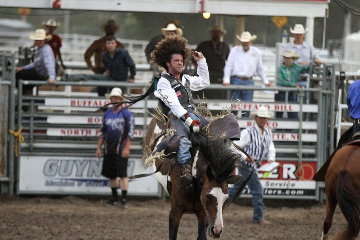 Texas cowboy ties arena mark in bareback on final night of Buffalo Bill Rodeo